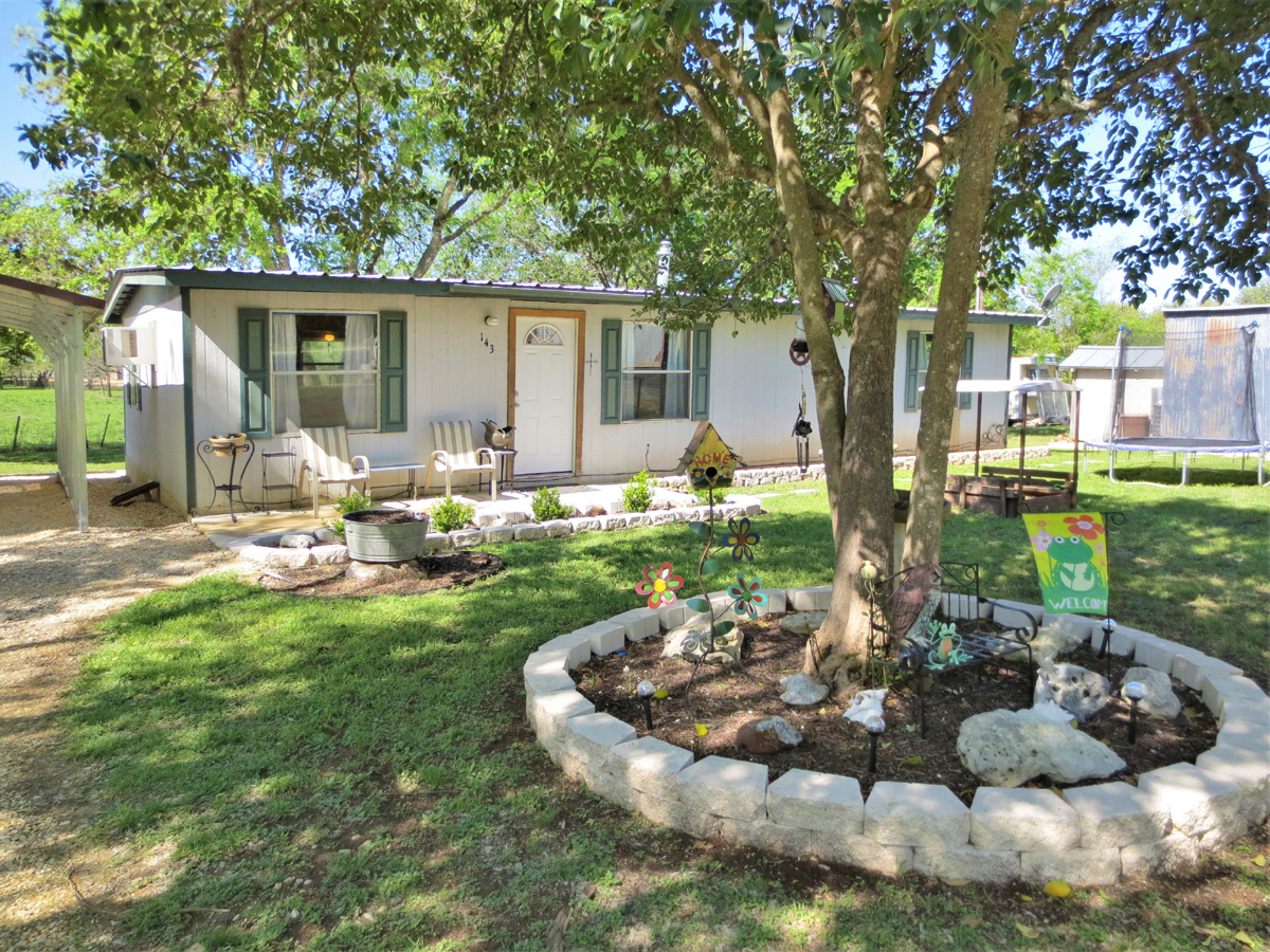 View from front left of home #1. TWO HOMES on a HALF ACRE in MEDINA in the Texas Hill Country. Listed for sale with Gail Stone Realty in Bandera, TX. 830-796-4640