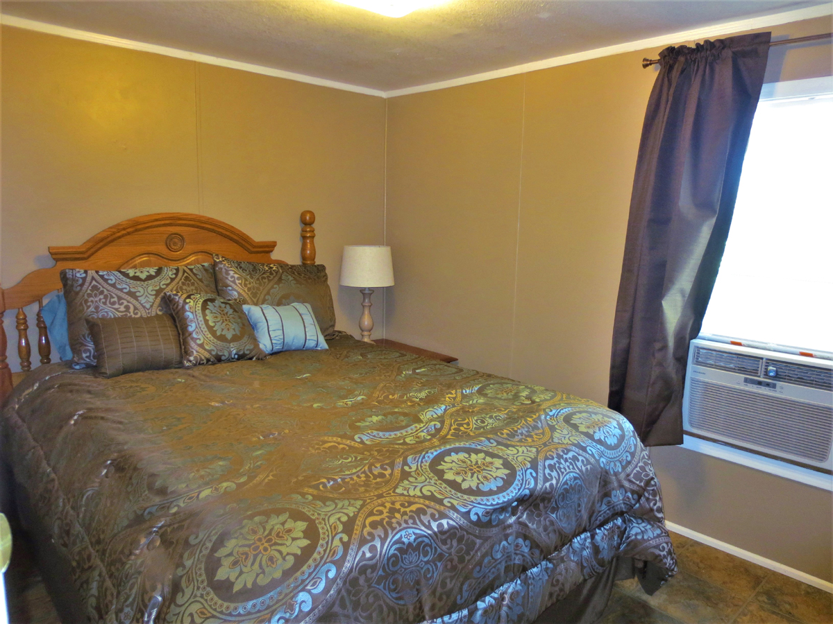 Bedroom. TWO HOMES on a HALF ACRE in MEDINA in the Texas Hill Country. Listed for sale with Gail Stone Realty in Bandera, TX. 830-796-4640