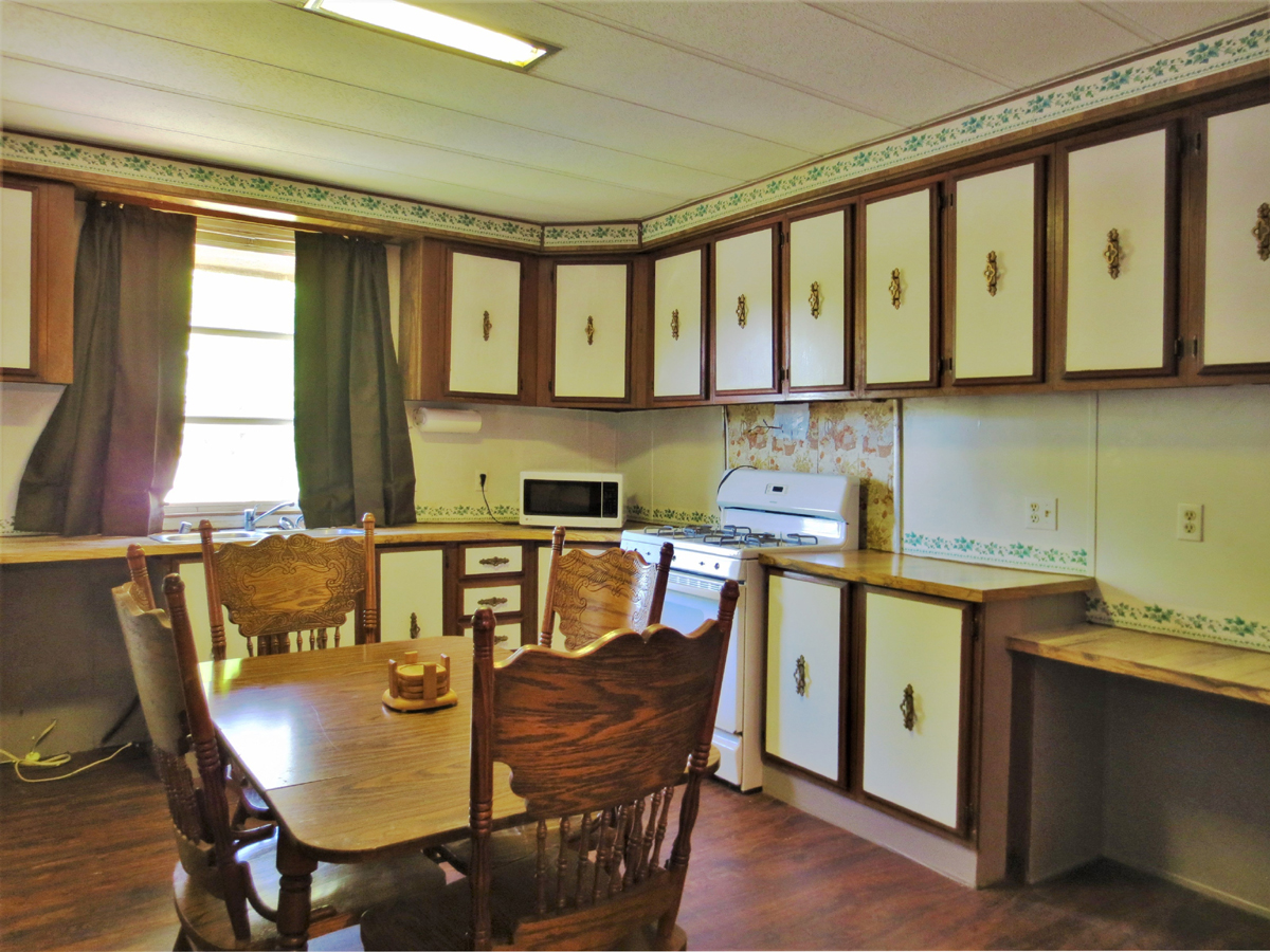 Lots of cabinets in the eat-in kitchen. TWO HOMES on a HALF ACRE in MEDINA in the Texas Hill Country. Listed for sale with Gail Stone Realty in Bandera, TX. 830-796-4640