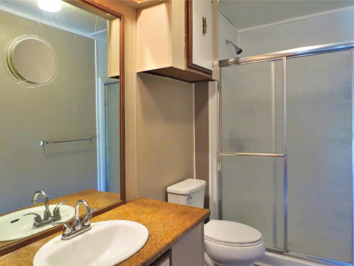 Bathroom. TWO HOMES on a HALF ACRE in MEDINA in the Texas Hill Country. Listed for sale with Gail Stone Realty in Bandera, TX. 830-796-4640