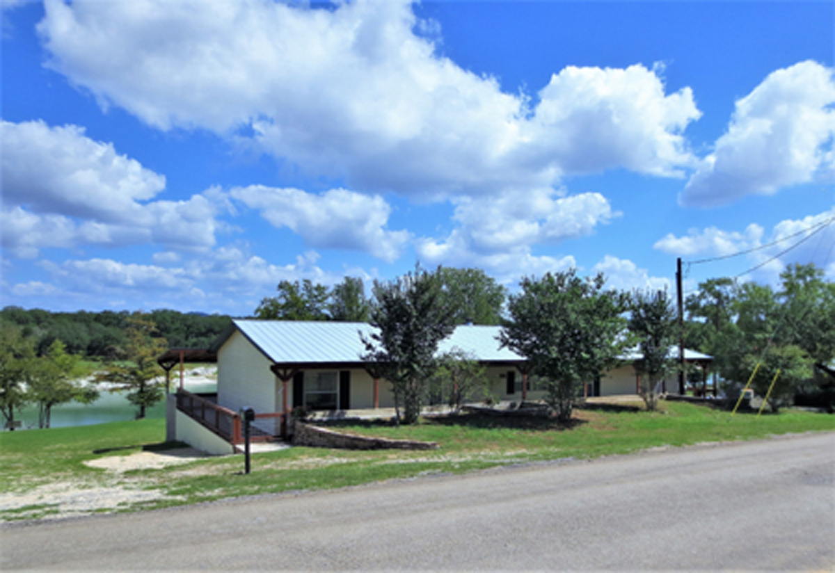 View of house from street. Medina Riverfront Home in the Texas Hill Country listed for sale with Gail Stone Realty. 830-796-4640
