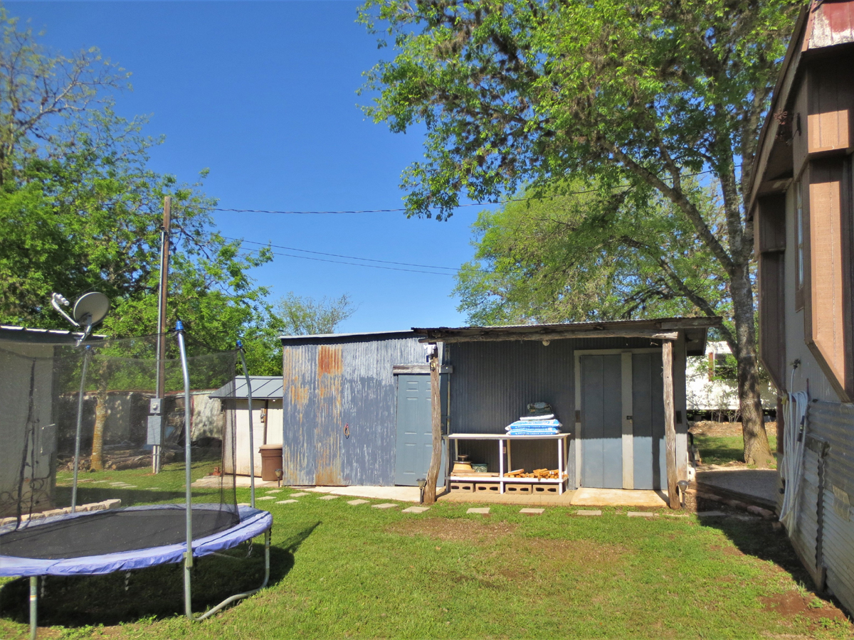 Storage buildings. TWO HOMES on a HALF ACRE in MEDINA in the Texas Hill Country. Listed for sale with Gail Stone Realty in Bandera, TX. 830-796-4640