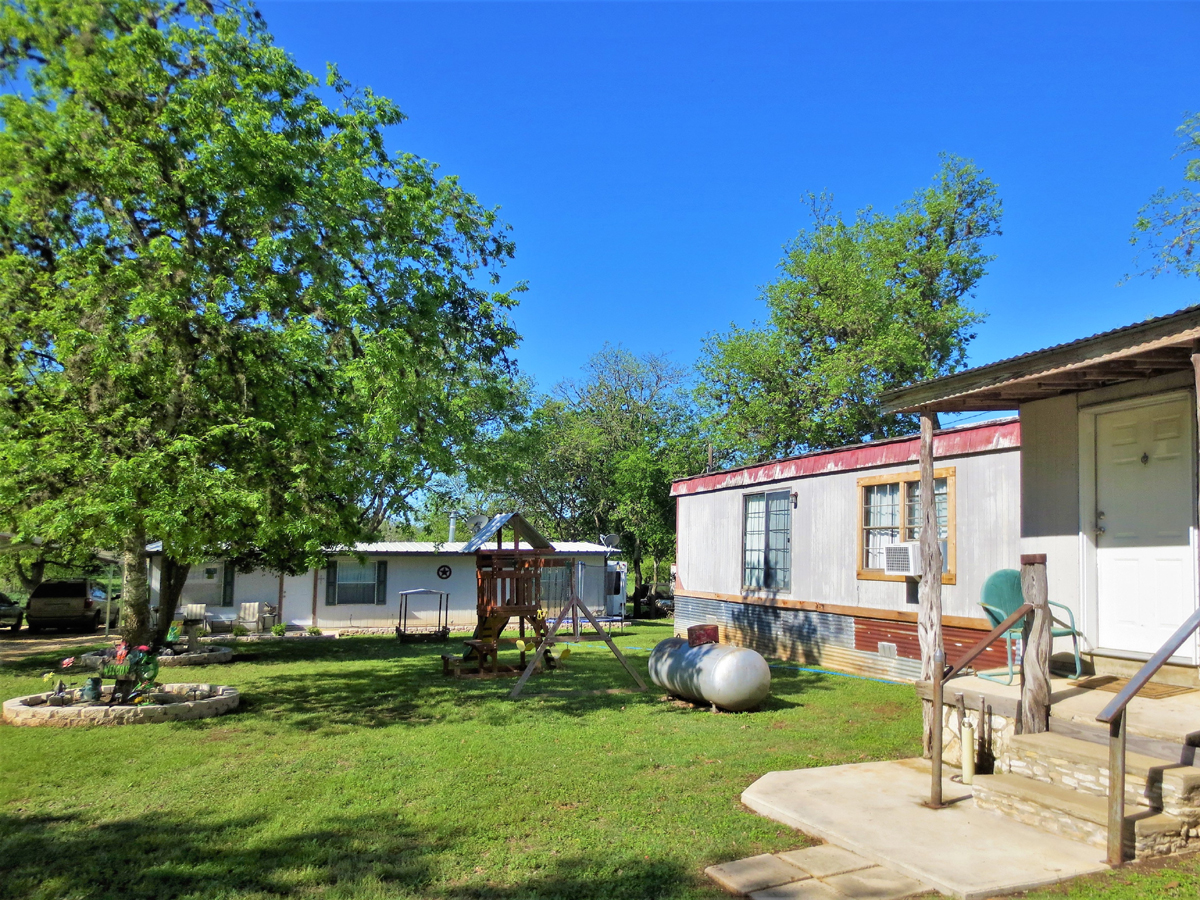 Backyard. TWO HOMES on a HALF ACRE in MEDINA in the Texas Hill Country. Listed for sale with Gail Stone Realty in Bandera, TX. 830-796-4640