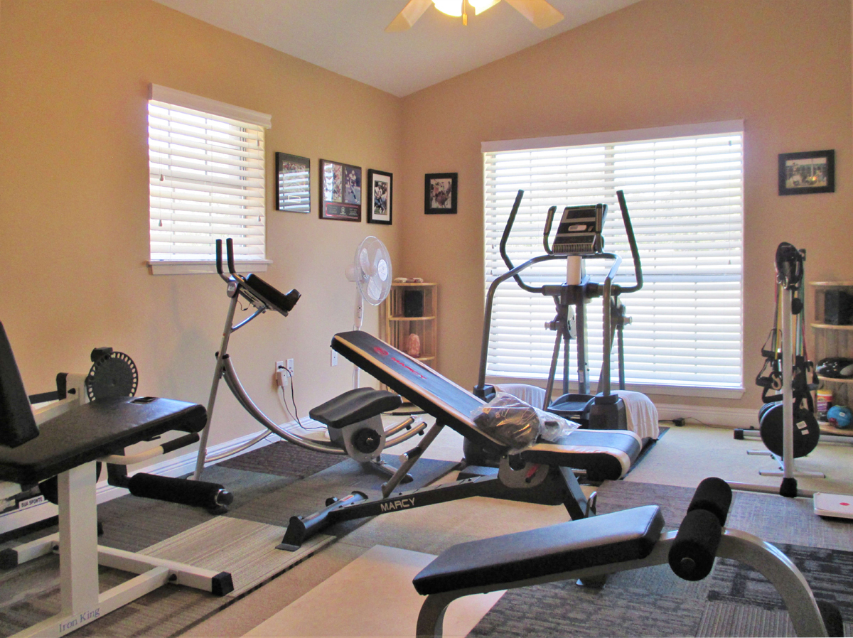 Bedroom used as an exercise room at 503 Oak Bend.