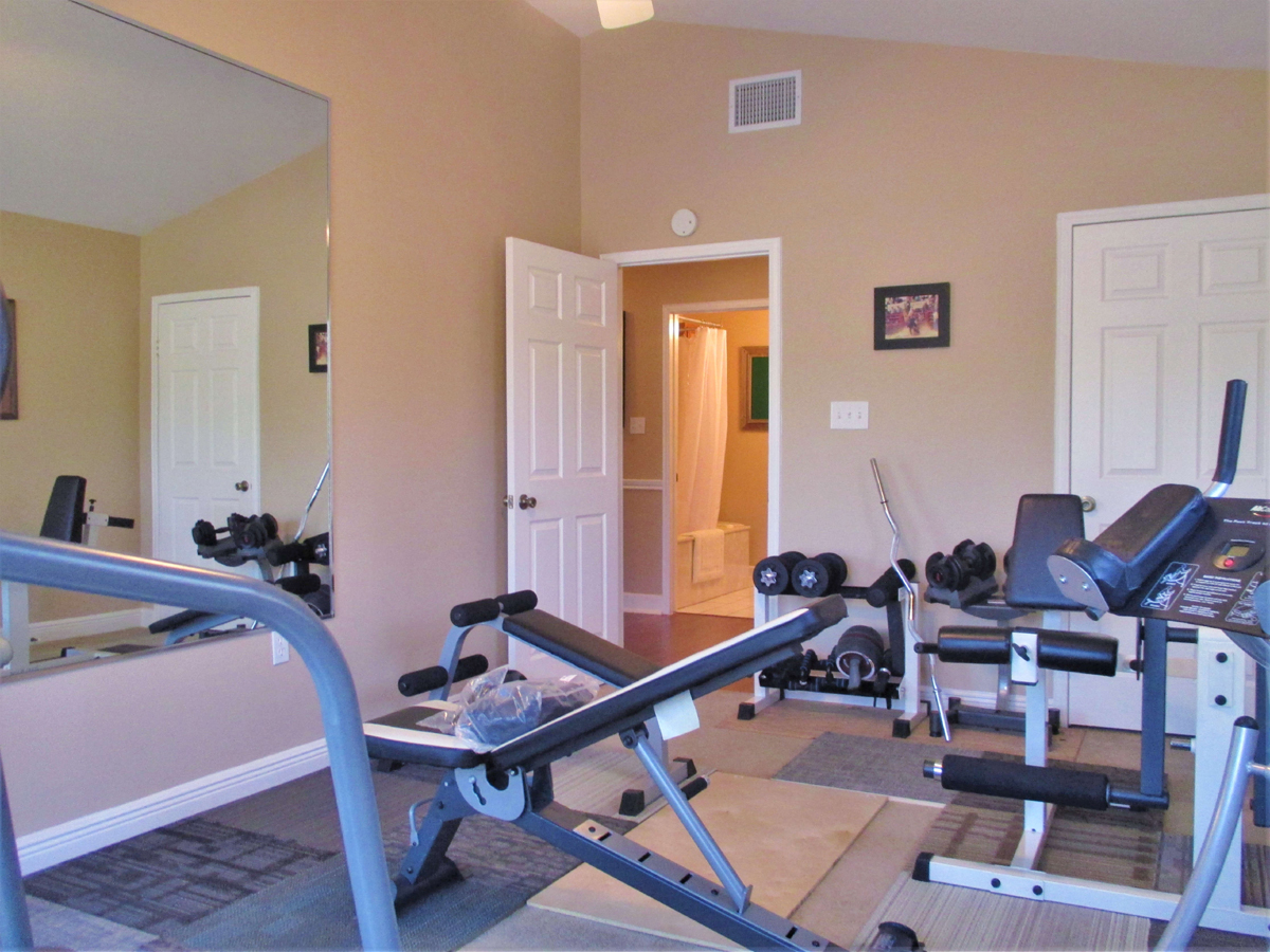 This bedroom is currently used as an exercise room at 503 Oak Bend.