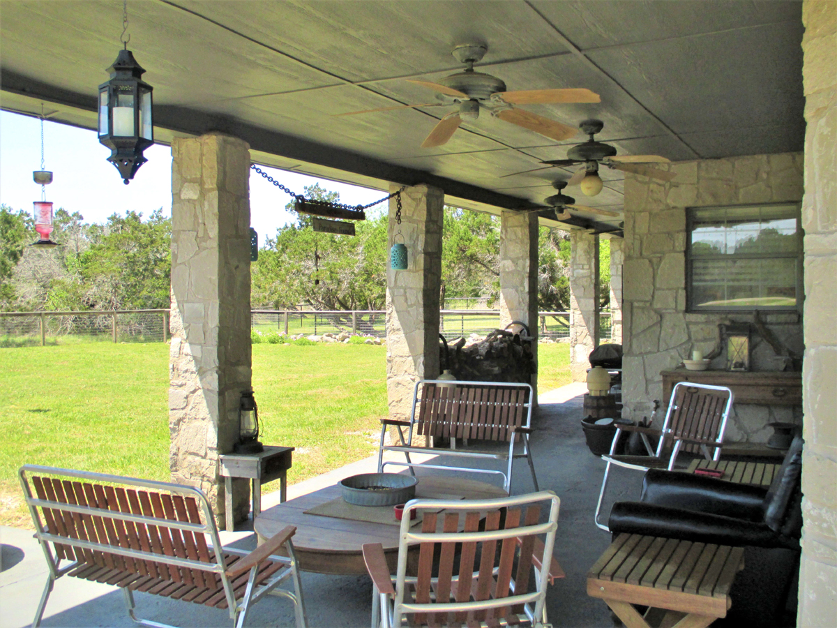 Extra large back porch for entertaining at 503 Oak Bend.