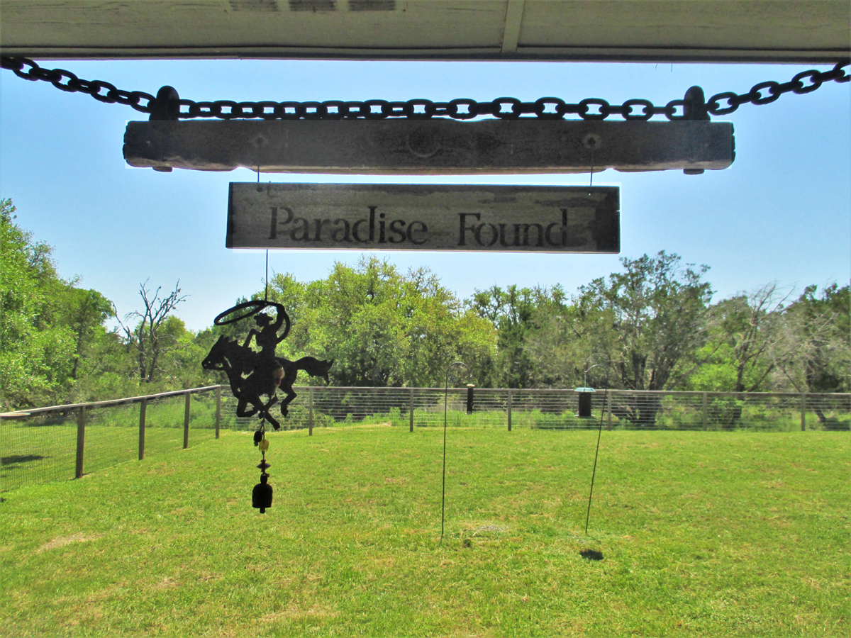 """Sign reads """"Paradise Found"""" at 503 Oak Bend."""