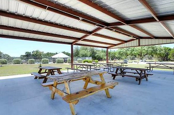 Huge covered pavilion for family reunions at the Bandera River Ranch.
