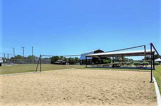 Volleyball court with sand at the Bandera River Ranch.