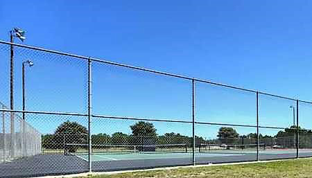 Tennis courts at Bandera River Ranch have night lighting and high fences
