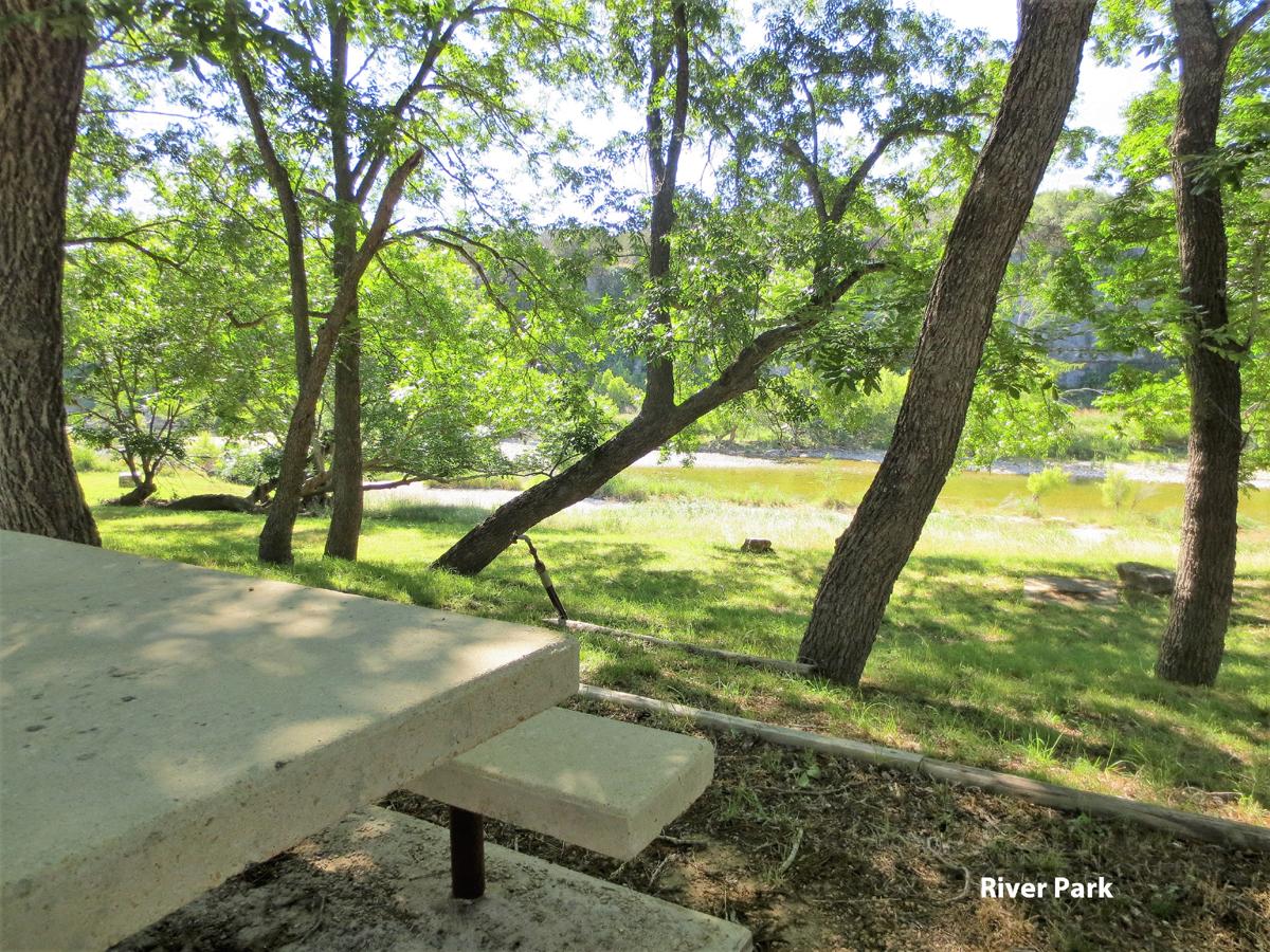 Picnic table at the Comanche Cliffs River Park.