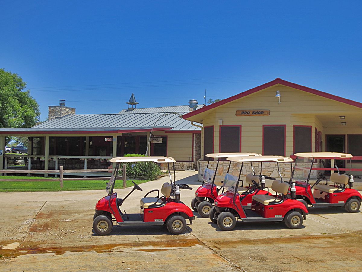 Clubhouse and golf carts at the Flying L Ranch.