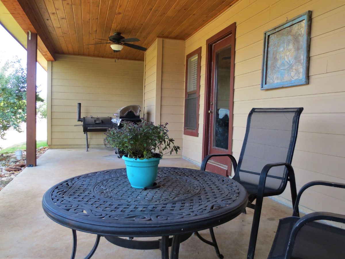 Table and chair on back porch of Wagon Trail