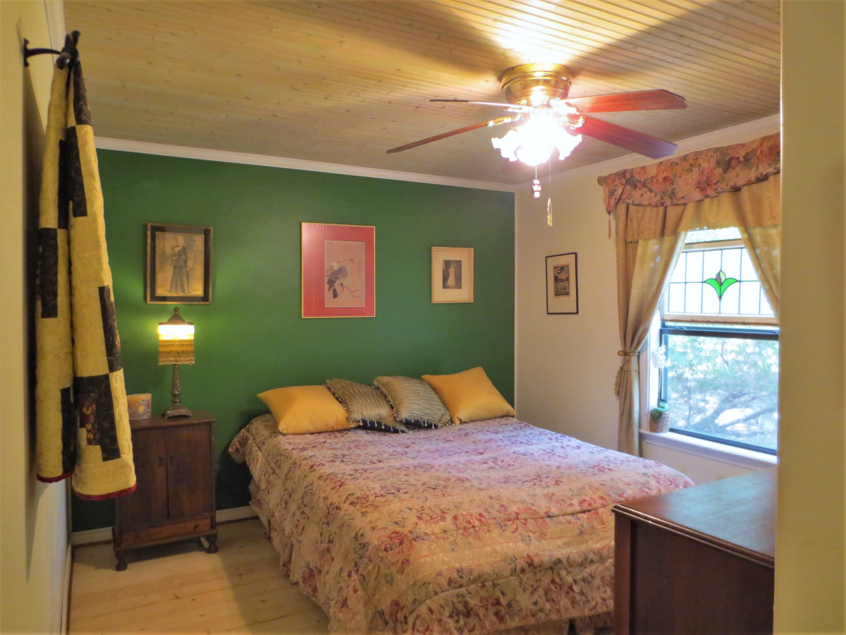 Bedroom 2 with bead-board ceiling