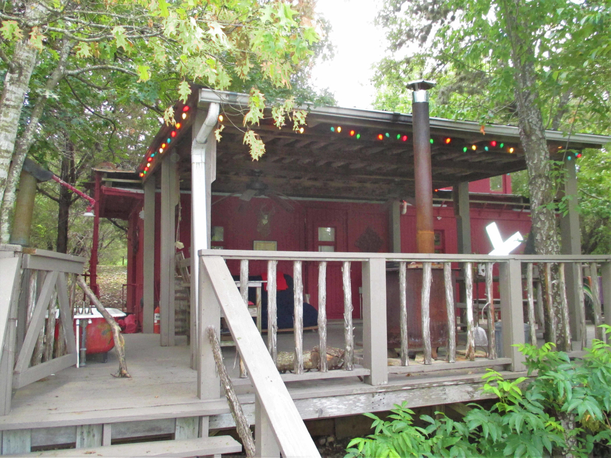 Treetop Caboose on the River H0236. Listed for sale with Gail Stone Realty, Bandera, Texas.