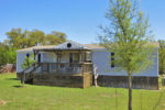 H0228/Holiday Villages: located in a a quiet, gated community near Bandera, TX in the Texas Hill Country. Listed for sale with Gail Stone Realty. 830.796.4640