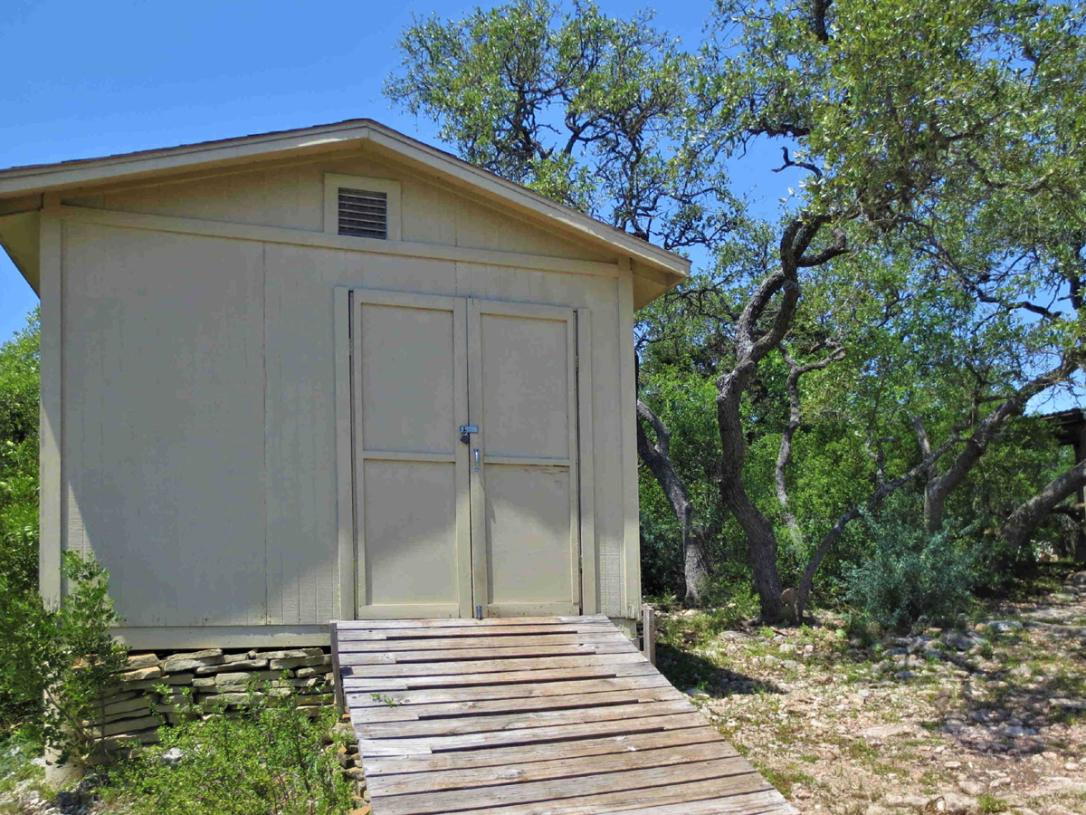 Storage building and oak trees